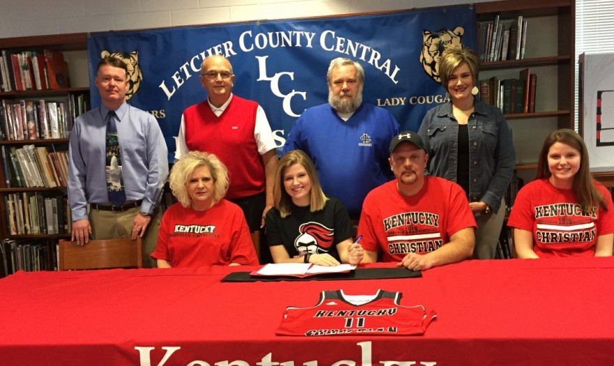 Shelby Hall signs with Lady Knights as family, coaches and administrators watch